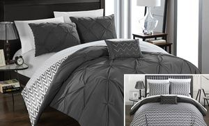 Groupon - Nadette Reversible Pinch-Pleat and Chevron Comforter Set (3- or 4-Piece). Groupon deal price: $49.99