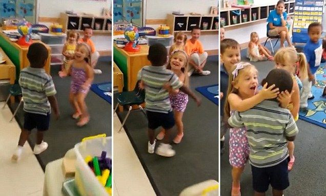 Father films the moment his son is embraced by classmates