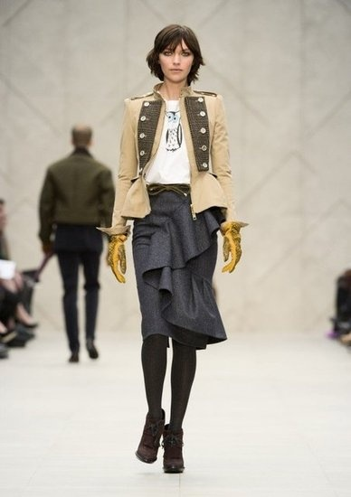 Burberry. Love the skirt. Jacket is just meh. though this is a great outfit for Eponine in Les Mis! lol.