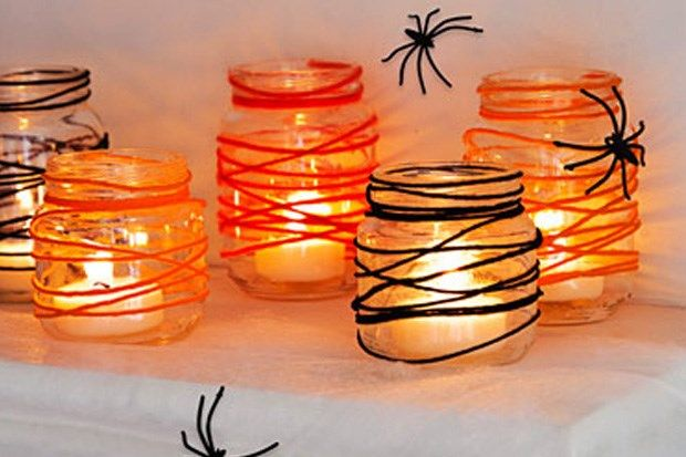 Wrap string around tealight mason jars to give it that spider-web look.