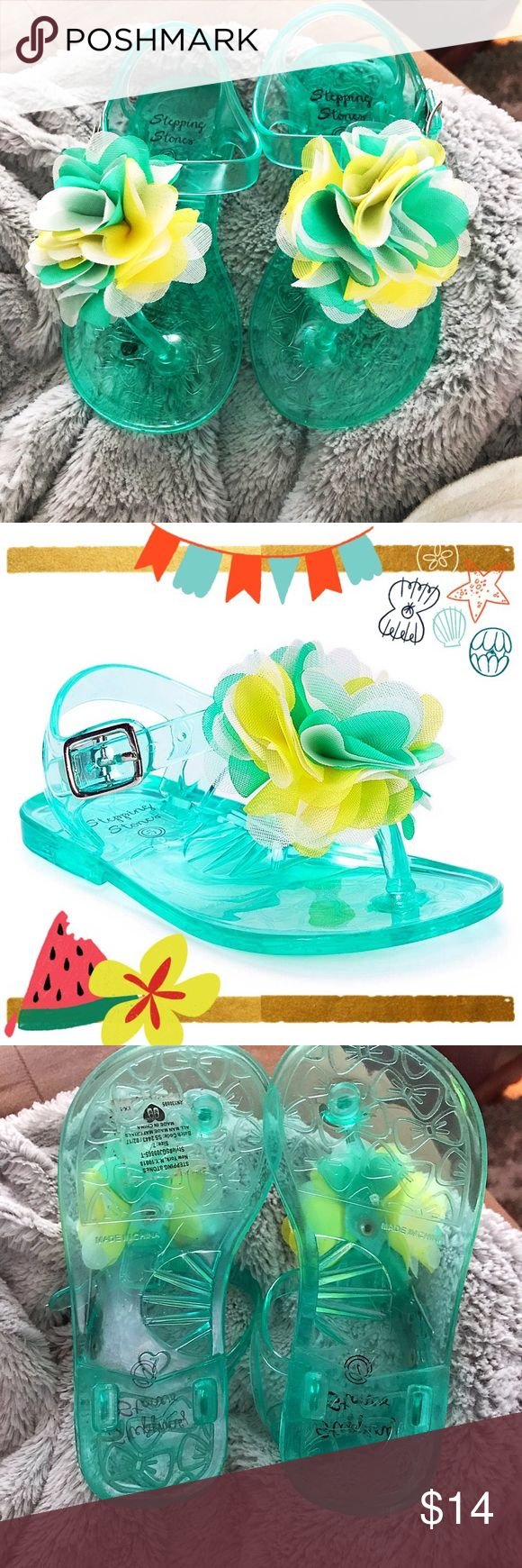 💚 Rosette Jellies 💛 💚💛new without tags! 💛💚 Accessorize her look with these adorable ѕandalѕ 💚Stepping Stones sandals Jelly plastic upper Thong toe Buckle at ankle 💚💚 Turquoise, Yellow, and White Chiffon rosette at forefoot. 💚 Color: Turquoise 💚 Size 7 ĸιdѕ 💛 stepping stones Shoes Sandals & Flip Flops
