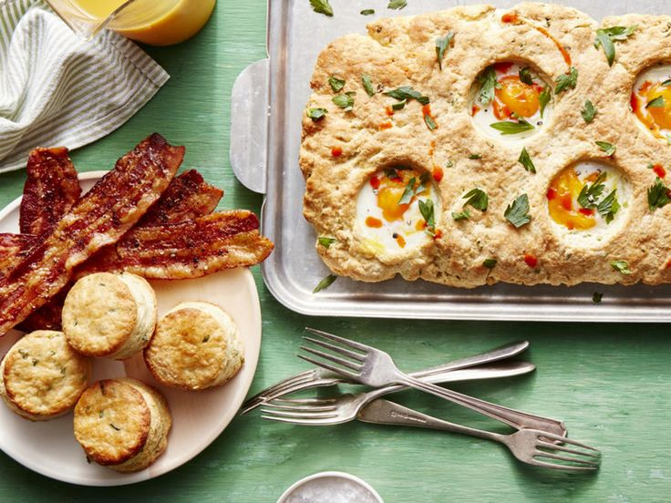 """Our sheet pan take on """"egg-in-a-hole"""" is such a perfect play for a fun, and totally photogenic, weekend brunch. A slab of rich, tender,..."""