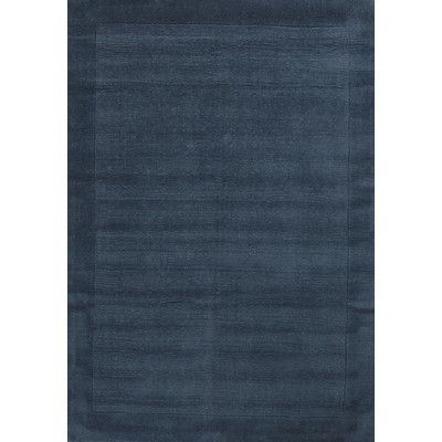 Hand loomed tufted   contemporary rug. Pile height 2cm. Made of wool