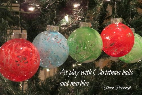 At play with Christmas Balls and Marbles by Teach Preschool