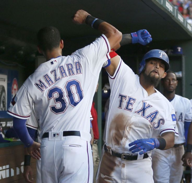 Texas Rangers second baseman Rougned Odor (12) celebrates with Texas Rangers right fielder Nomar Mazara (30) after hitting a home run in the third inning against the Houston Astros at Globe Life Park in Arlington, Texas, Monday, June 6, 2016. (Rose Baca/The Dallas Morning News)