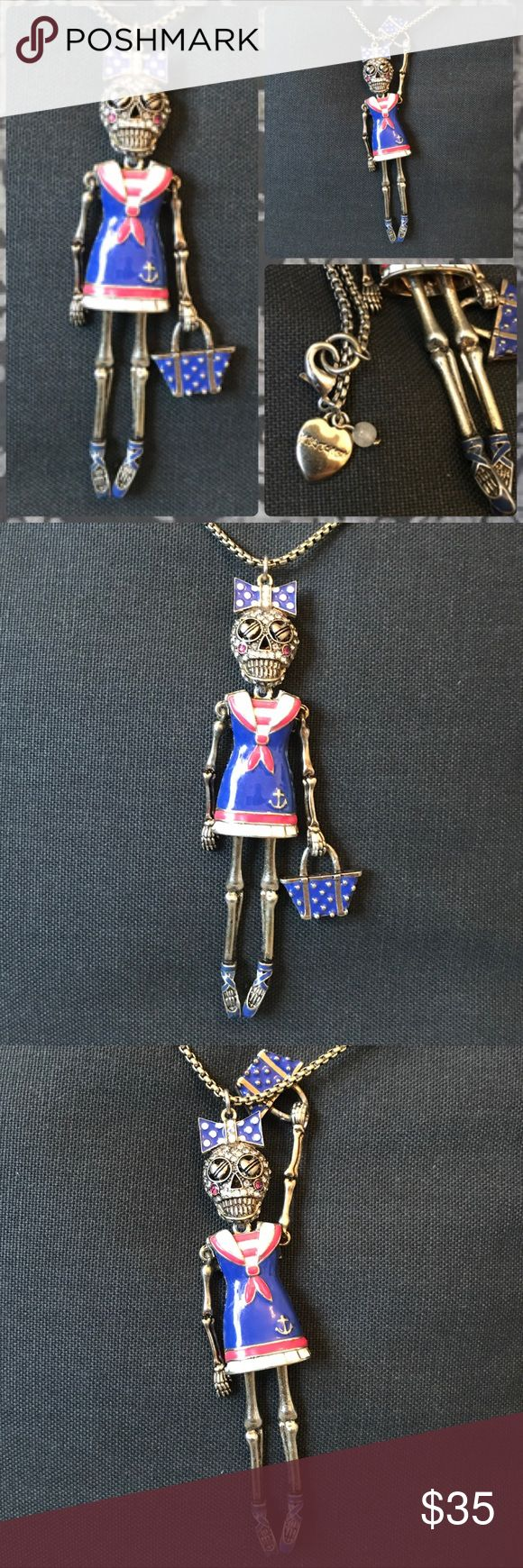 Authentic Betsey Johnson Sailor Skeleton Girl Authentic brand Betsey Johnson necklace and earrings featuring a nautical sailor bedazzled skeleton girl with a purse, shiny jewels, bow, ballerina shoes and sailor dress in pink and blue with heart eyes. Head, limbs, and purse are all able to move. Chain is very long and nice quality. Now and bag features polka dots. I have several other BJ items up for sale, I bundle at 20% off and ship next day, let me know if you are interested. Great for…