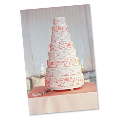 Tall White and Peach Wedding Cake | This wedding cake towers with eight tiers and an intricate floral motif.