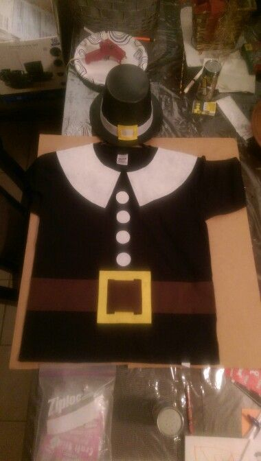 Pilgrim costume using a black tshirt and pieces of felt glued on with hot glue.
