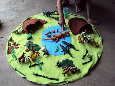 DIY~ Dinosaur playmat- it even turns into a draw string storage bag! This concept is great for legos or other play sets on the go too. - perfect for my new nephew!