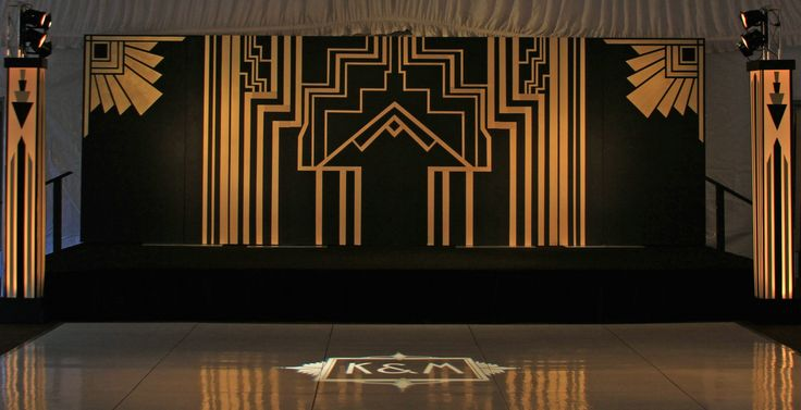 Custom band backdrop and columns lit from within were created by Get Lit to realize a bride's dream for an art deco wedding at the Biltmore Estate.  A custom monogram gobo in an art deco style highlights the dance floor.