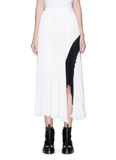 Optical play is always part of Proenza Schouler's game, as showcased in this midi skirt. Plissé pleated to create tempered proportions, this crepe piece features a contrast stroke spanning across the front and leading to an asymmetric arch at the hem.
