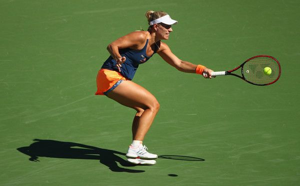 Angelique Kerber Photos Photos - Angelique Kerber of Germany plays a forehand against Pauline Parmentier of France in their third round match during day eight of the BNP Paribas Open at Indian Wells Tennis Garden on March 13, 2017 in Indian Wells, California. - BNP Paribas Open - Day 8