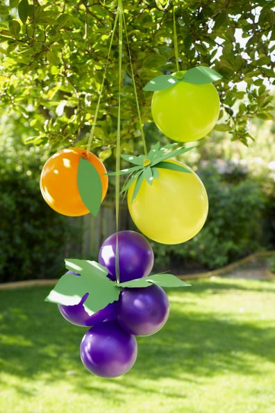 It is so easy to turn your balloons into FRUIT! A cute way to decorate for a summer party.