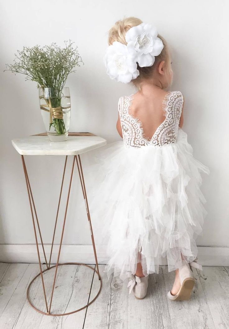This item is Available Now. It sits roughly at shin/ankle length it has 5 layers of tulle. With a gorgeous scalloped lace back Comes with two detachable flowers that can be worn on the dress or in your hair. We recommend measuring to get the right fit ,the top part of the dress (lace )has stretch too it. They also have a stretch waist .  Approx Measurements  1-2 56cm length 21cm Half Chest  2-3  24cm  Half chest  length 65cm  3-4 26cm half chest length 70cm  4-5 length 76cm 28cm Half che...