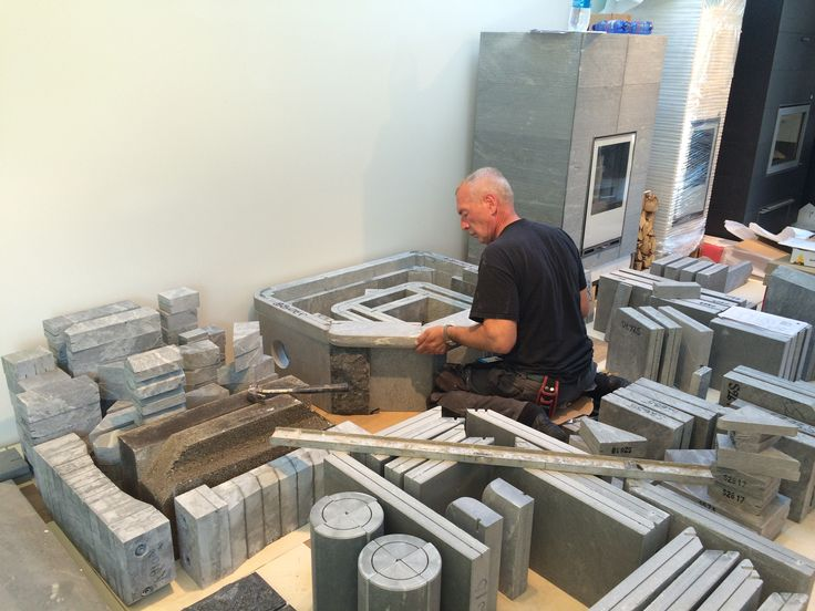 TLU2637/11 fireplace with bakeoven – one of Tulikivi's most loved models being assembled for Finland's largest housing fair. #asuntomessut #asuntomessut2015 #vantaa http://www.tulikivi.com/en/products/TLU2637_11