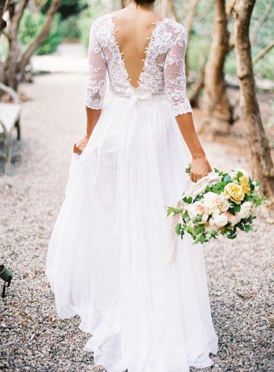 Deep lace V in the back of this wedding dress: http://www.stylemepretty.com/2014/07/22/wedding-dress-back-styles-we-love/