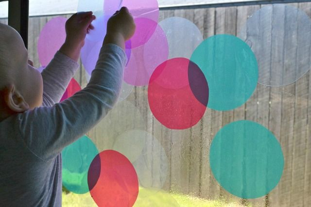 color and shapes play via howwemontessori.com. cutouts made from plastic pocket protectors