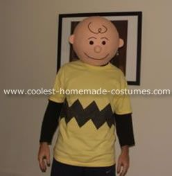 Charlie Brown.  Homemade with a jiffy marker on the shirt and papier mache head.  Awesome job.