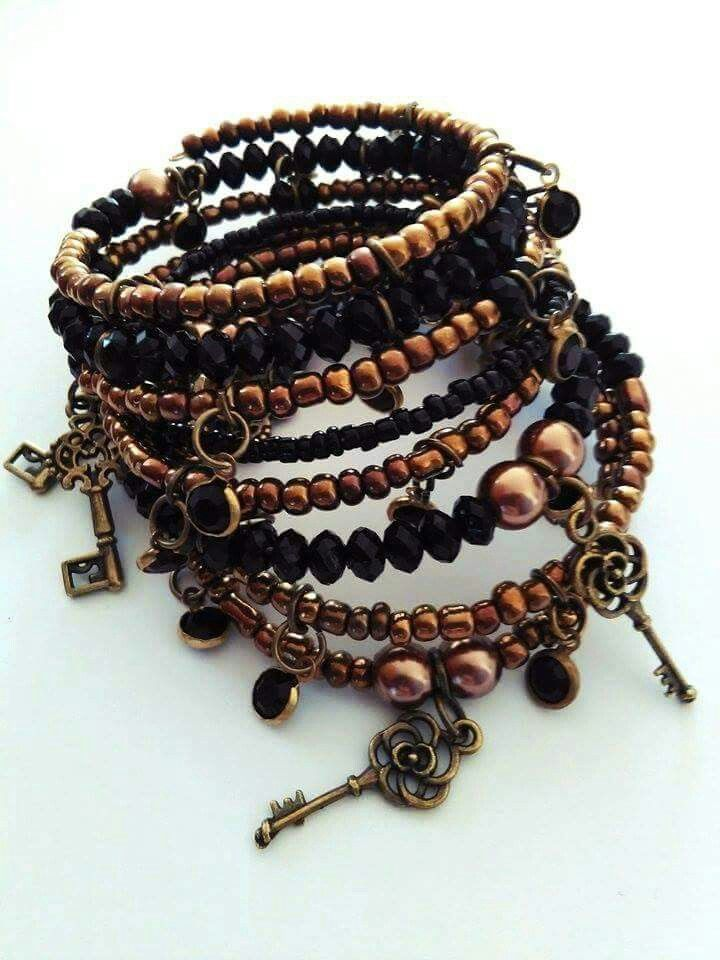 My favorite black bronze memory wire bracelet. This bracelet is made with bronze tones of seed beads (I adore them) also here are acrylic delicate charms and  some key pendant pendants. For more my creation find me on Etsy https://www.etsy.com/shop/AmorPorteno?ref=hdr_shop_menu