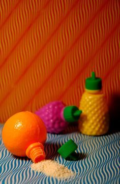 I used to eat the sugar powder, then hang the little fruit containers around the attic bedroom. Colourful and cute. Coincidentally, 40 years later, my decor once again involves fruit!
