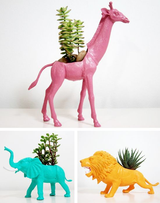 DIY Giraffe, lion & elephant planters. These are made from plastic toy figures you can get at cheap stores. Cut a hold in the back and paint! Super easy and super fun!