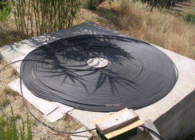 Solar powered swimming pool heater. http://poolheater.org.uk