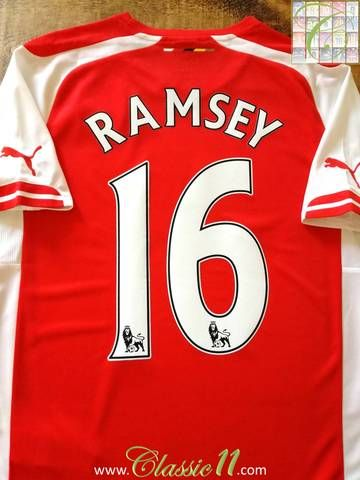 Official Puma Arsenal home football shirt from the 2014/15 season. Complete with Ramsey #16 on the back of the shirt in Premier League lettering.