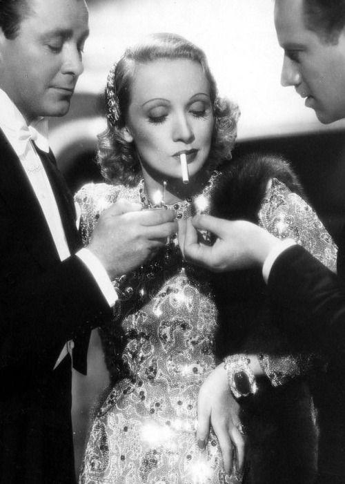 Herbert Marshall,Marlene Dietrich,and Melvyn Douglas