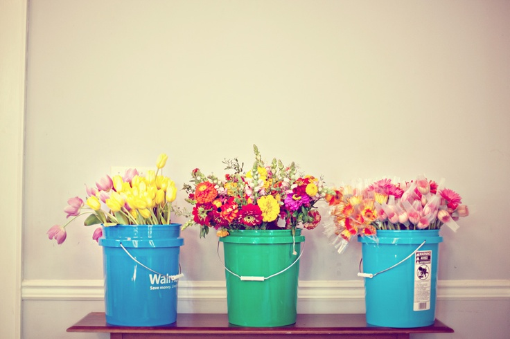 Colorful zinnias and tulips make even buckets looks fresh and cheerful.