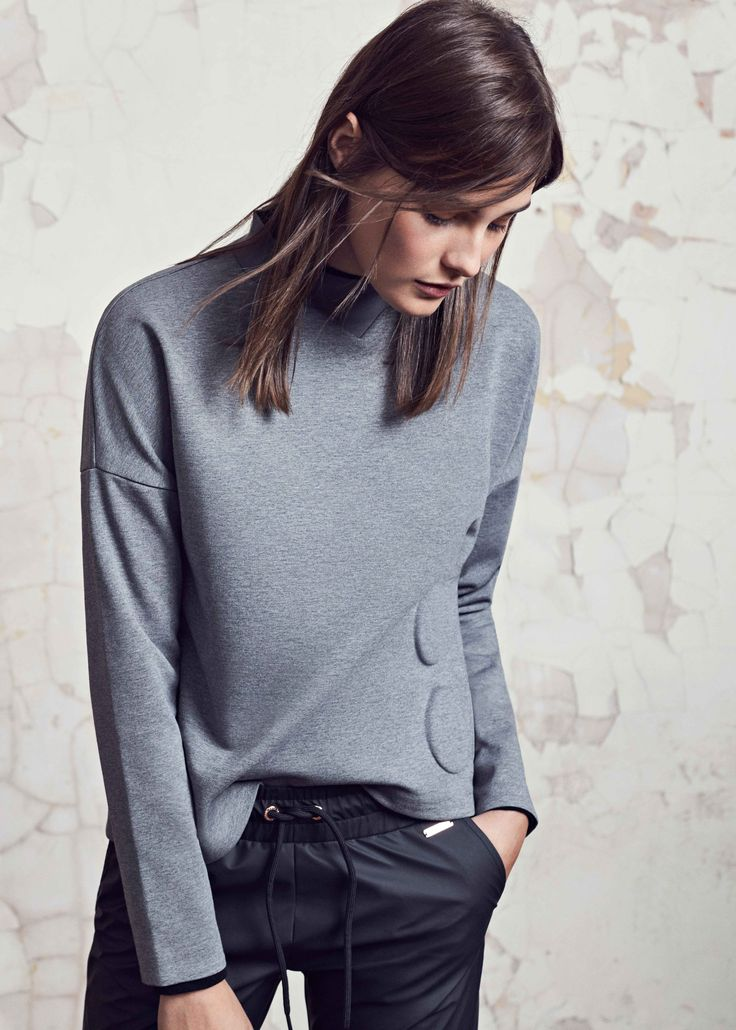 Go from workout to street in style in this cool, high neck sweat. We recommend layering over leggings or cropped trousers for London style.