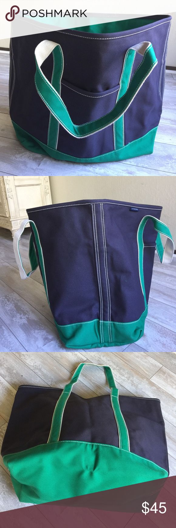 """Lands' End X-large Navy Zip-top Canvas Bag.17255 Bag composed of 24 oz.100% """"navy"""" cotton csnvas, reinforced trim, handles and bottom in """"dark Kelly green"""" is endlessly durable, weight tested to hold 500 lbs. when only handles break! Stands upright when empty. A large snapped interior pocket and key fob on one side with 3 open pockets other interior side; one exterior pocket. 9.25"""" handle drop allows bag to be carried over shoulder. 25"""" long polyester zipper top closure. Use for travel…"""