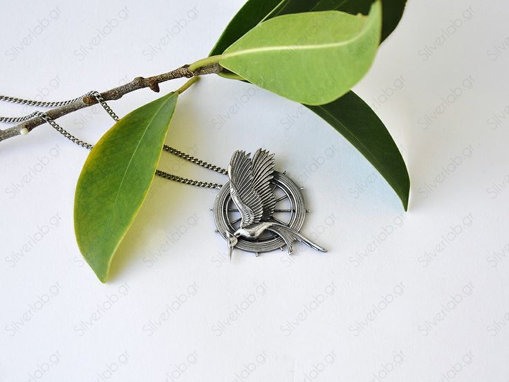 https://www.etsy.com/listing/151164873/hunger-games-mockingjay-pendant-katniss