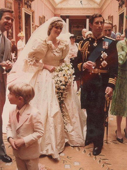 14 Never-Before-Seen Photos of Prince Charles and Princess Diana's Wedding |  | The newlyweds in a candid, intimate moment just after saying their vows at St. Paul's. Diana's iconic dress was crafted by British fashion designers David and Elizabeth Emanuel.
