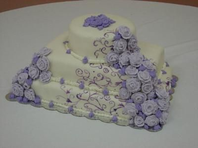 Homemade Wedding Cake For A Friend: I love making cakes and with the high costs of most weddings, I try and help friends by doing the cakes for them at a huge discount.   This is a cake that