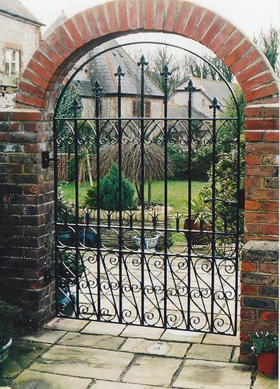 Not So Crazy About The Wrought Iron But Love The Brick Arch Iron Garden Gates Garden Gates