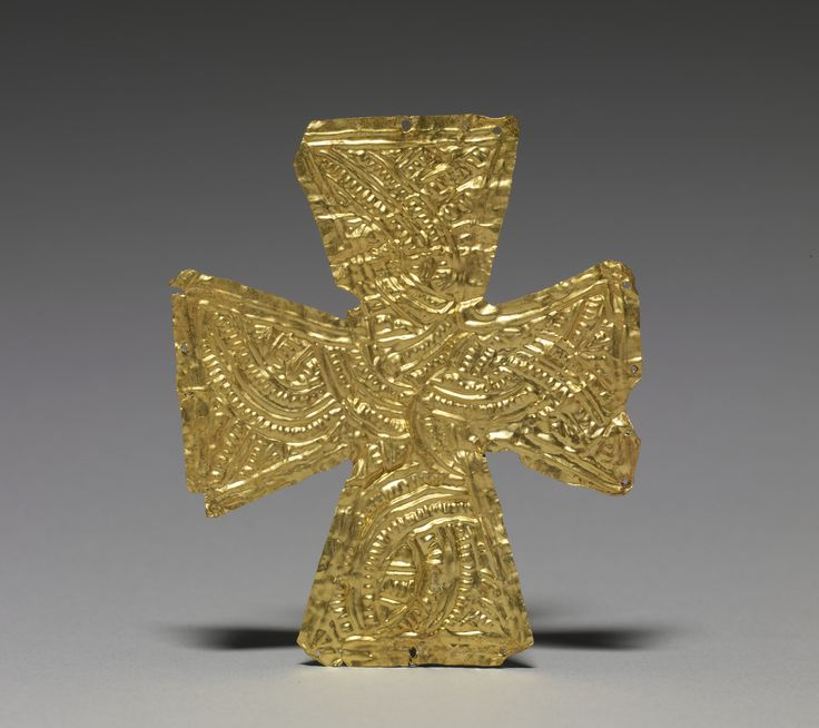 Little lombard funeral cross. When the Lombards became christians these little golden crosses were sewn on top of the shroud. You can see little holes for the wire at the extremities of the arms of the cross.