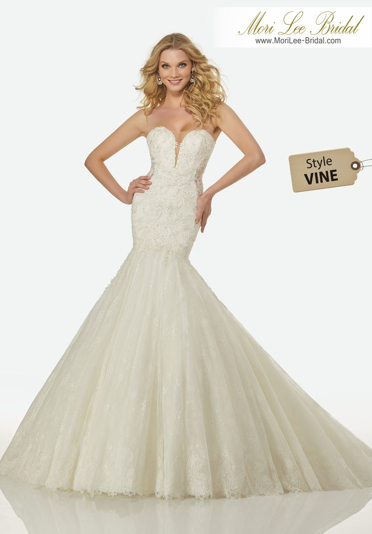 Style VINE ARIA WEDDING DRESSSweetheart, Strapless Mermaid Gown of Beaded Chantilly Lace with Sheer Side Insets and Plunging Neckline.Colors: IVORY, IVORY/CHAMPAGNE