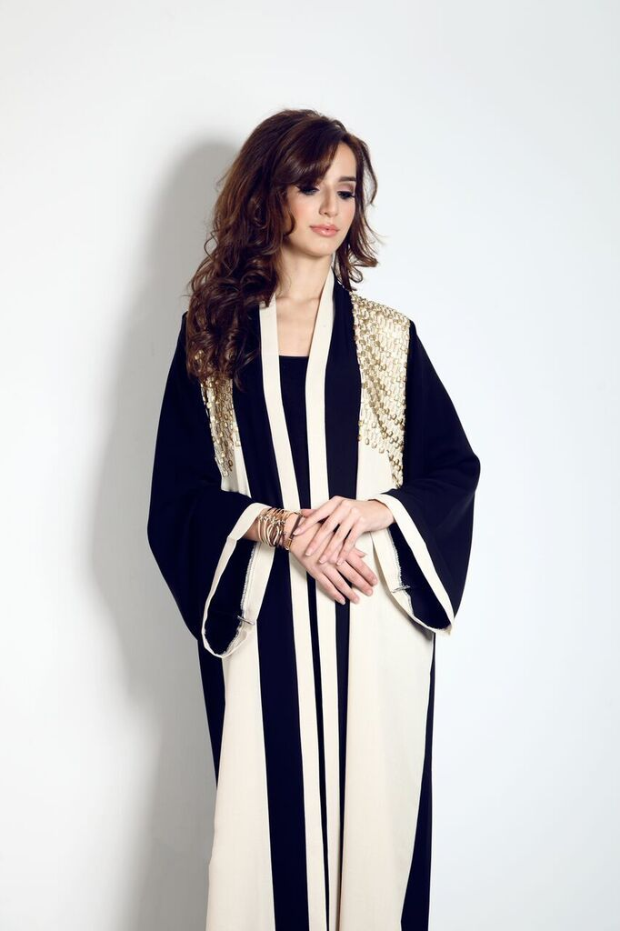 Get this beautiful Abaya with linen panels and matte gold embriodary from our website now for only £89