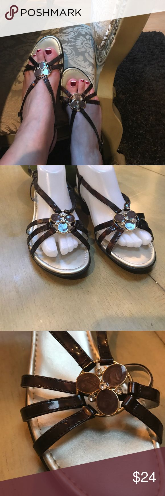 Easy spirit sandals 8.5 These are very cute sandals 8.5 brown and gold design with stones worn a few times in great condition. Heel height 1.5 inches Easy Spirit Shoes Sandals