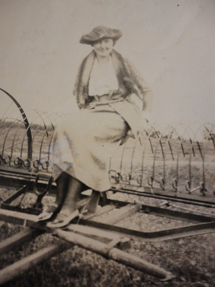 Antique Photos // 1910s // Photo of a Woman Dressed Beautifully Sitting on Farming Equipment