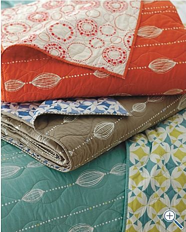 Im not even sure there is a link...but what lovely and simple whole cloth quilts!