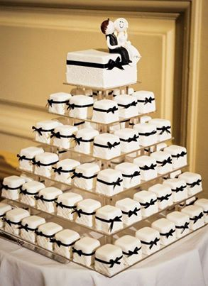 square mini cup cakes in stead of having a regular cake so the cake doesn't have to be cut. LOVE this idea.