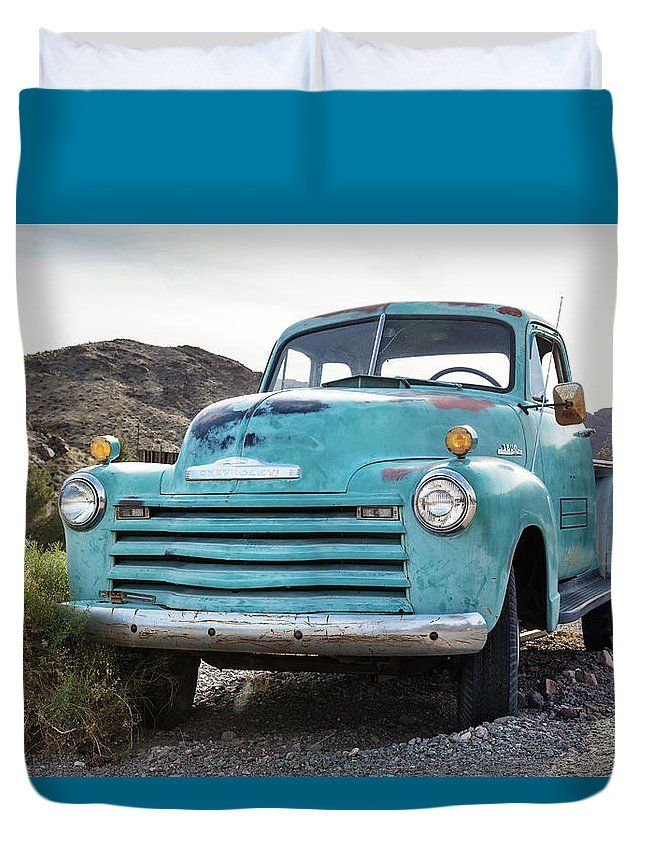 Duvet Cover featuring the photograph Blue Truck In Desert by Evgeniya Lystsova. Old rusty truck in Nelson Nevada Ghost town. Make your Bedroom special with stylish art products you choose! Our soft microfiber duvet covers are hand sewn and include a hidden zipper for easy washing and assembly. Your selected image is printed on the top surface with a soft white surface underneath. All duvet covers a machine washable. SHIPS WITHIN 3-4 business days!
