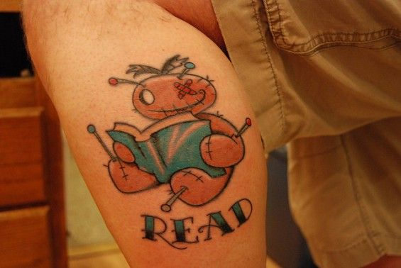 Jim McClusky is a librarian in Washington, so obviously he thinks reading is pretty darn important, even if you're only a poor little voodoo doll. Artwork by Mary J. Hoffman, tattoo by Curtis James of Anchor Tattoo.