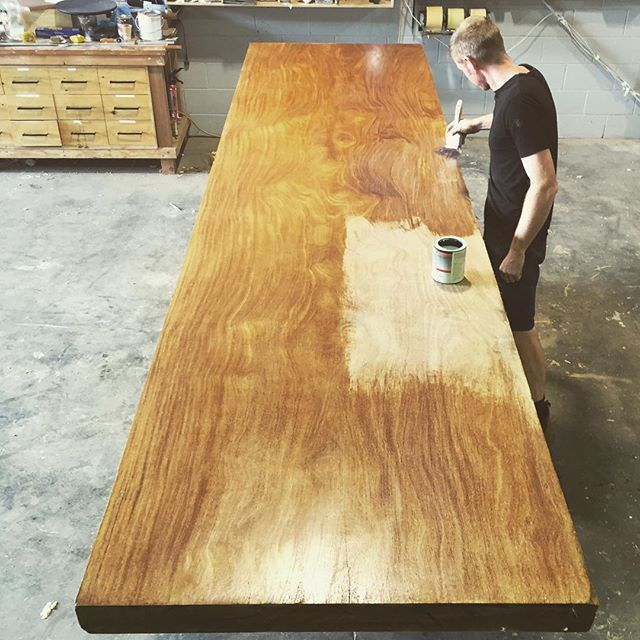 MASSIVE 4.5m Brazillian Tonka slab, 90mm thick! A temporary coat of sanding sealer before we start work on it. I'm giddy. #makimaki #timbertable #slabtable #woodwork #festool #furnituredesign #architecture #osmo #wood #brisbanemade