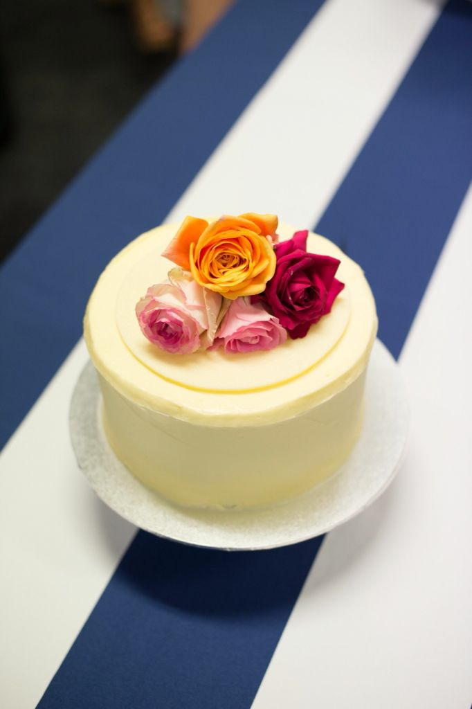 wedding cake, navy and white stripe theme, flowers, Photography: Milque Photography