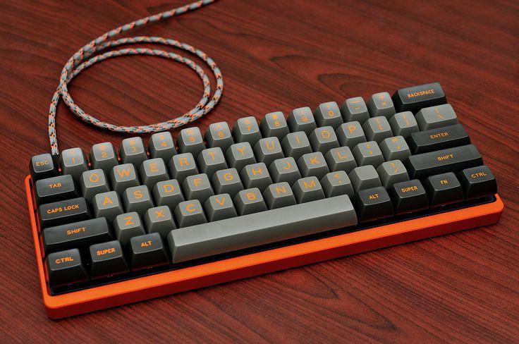techmattr's keyboard. Orange Tex case and Hack'd by Geeks keyset. Custom cable.