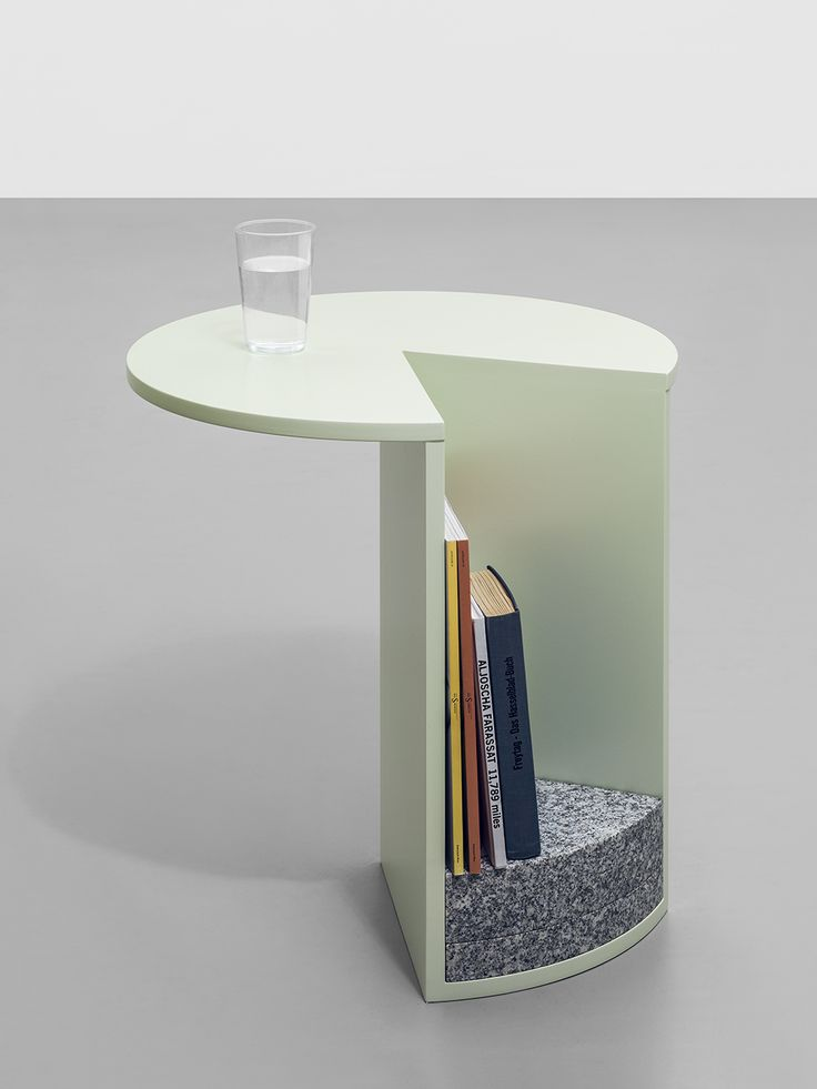 A granite slab keeps Pac side tables sturdy.
