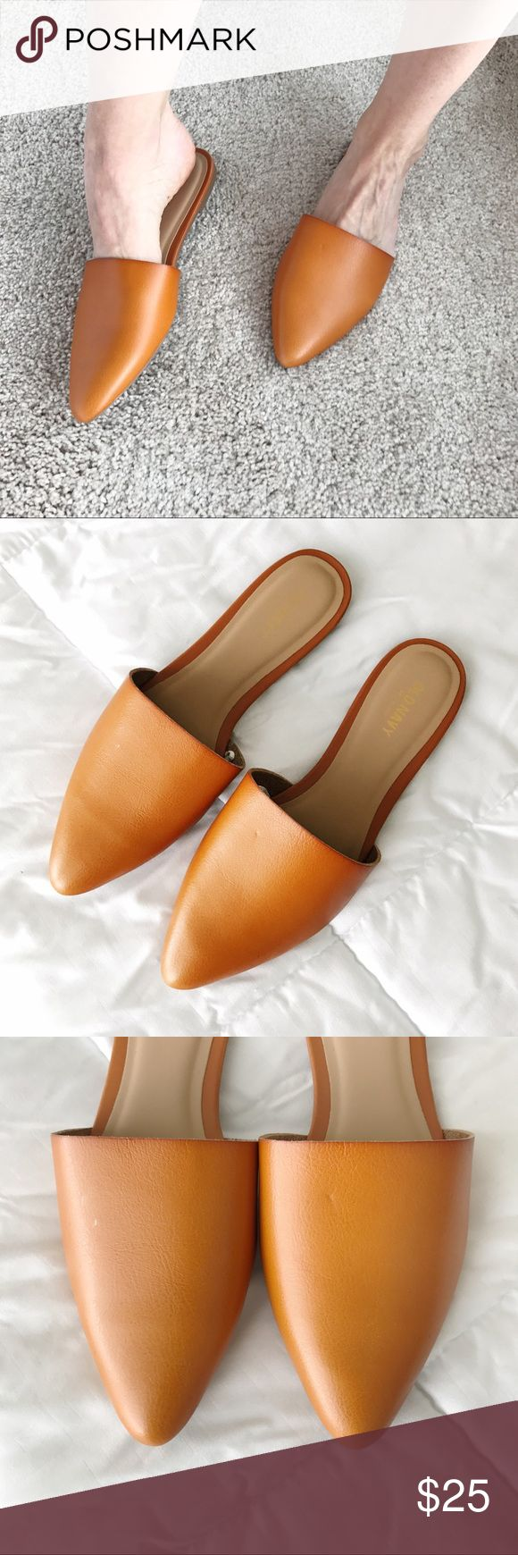 NWT Pointed Flat Mule Slipper 7 Sold out! Stunning slip on mules from Old Navy!! These are faux leather, but look like the real thing. The color is a rich English saddle, and looks very similar to Madewell's tan leathers. Will fit a 7-7.5. I constantly get compliments when I wear my mules. These are so comfortable, and look great with everything! I loved these so much I got 3 pairs. 🙈 A little extreme, so that's why I'm selling this pair! 🚫Trades 🚫PayPal Old Navy Shoes