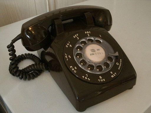 """It was called a """"telephone"""" and since the receiver was connected to the base with a cord, you couldn't wander far.  :)"""